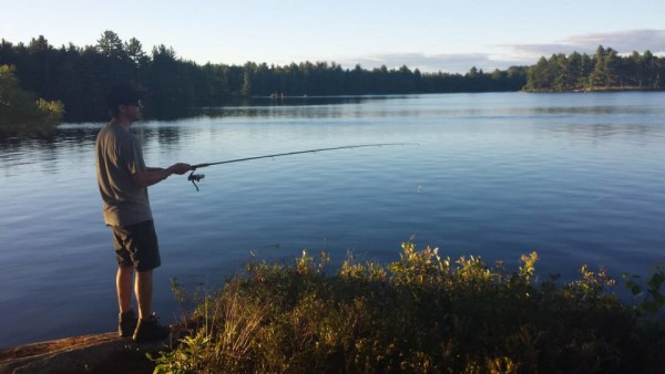 James fishing for bass on Wolf Lake in Ontario's Kawartha Highlands Provincial Park. © Lindsay Hawes
