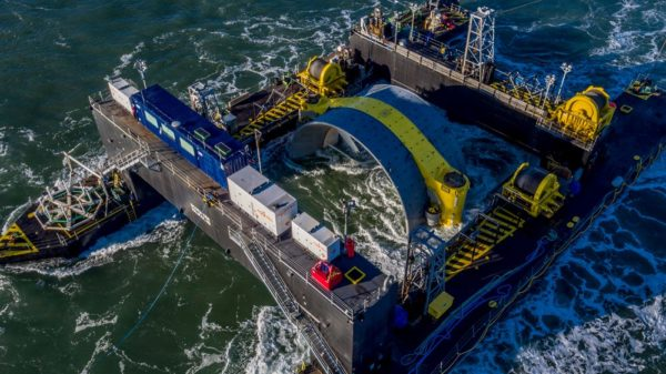 A tidal turbine being lowered into the Bay of Fundy. (Courtesy © Cape Sharp Tidal)